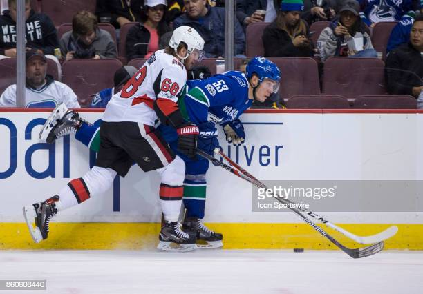 Ottawa Senators Left Wing Mike Hoffman checks Vancouver Canucks Center Bo Horvat during a NHL hockey game on October 10 at Rogers Arena in Vancouver...