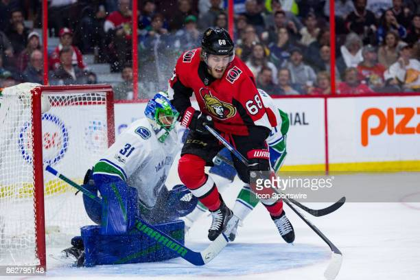 Ottawa Senators Left Wing Mike Hoffman jumps to avoid getting hit by a shot in front of Vancouver Canucks Goalie Anders Nilsson during second period...