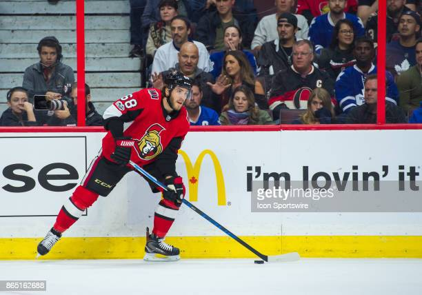 Ottawa Senators Left Wing Mike Hoffman stickhandles the puck against the boards during the NHL game between the Ottawa Senators and the Toronto Maple...