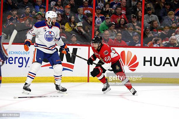 Ottawa Senators Left Wing Mike Hoffman tries to get away with Edmonton Oilers Defenceman Eric Gryba stick during a game between the Edmonton Oilers...