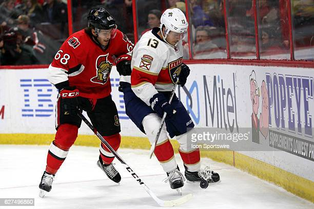 Ottawa Senators Left Wing Mike Hoffman uses his body to try and get to the puck controlled by Florida Panthers Defenceman Mark Pysyk during a game...