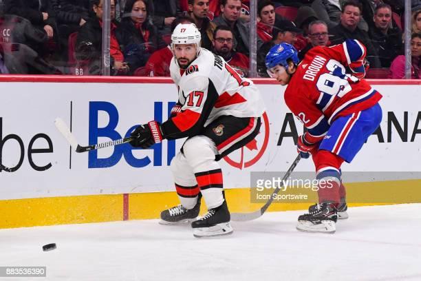 Ottawa Senators Left Wing Nate Thompson passes the puck before Montreal Canadiens Center Jonathan Drouin reaches him during the Ottawa Senators...