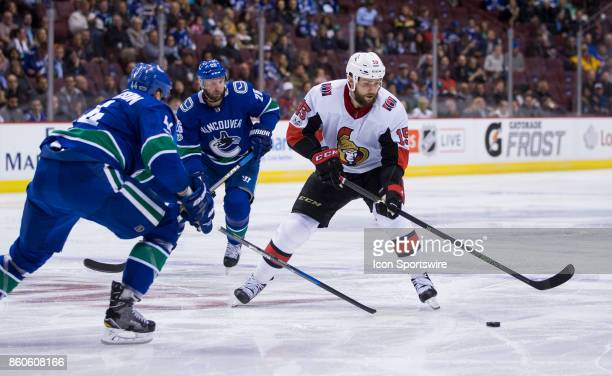 Ottawa Senators Left Wing Zack Smith drives on Vancouver Canucks Defenceman Erik Gudbranson during a NHL hockey game on October 10 at Rogers Arena in...