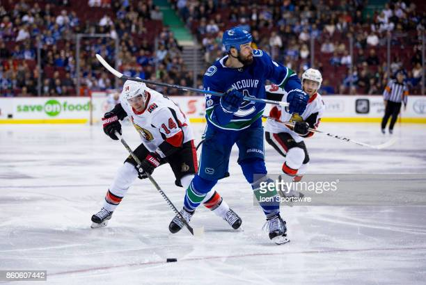Ottawa Senators Right Wing Alexandre Burrows attempts to check Vancouver Canucks Defenceman Erik Gudbranson during a NHL hockey game on October 10 at...