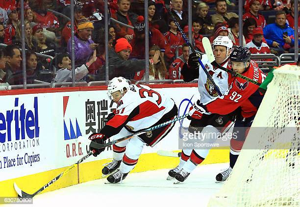 Ottawa Senators right wing Casey Bailey brings the puck around the back of the net chased by Ottawa Senators right wing Chris Neil and Washington...