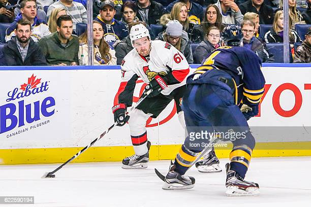 Ottawa Senators Right Wing Mark Stone looks to pas as Buffalo Sabres Defenseman Josh Gorges defends during the Ottawa Senators and Buffalo Sabres NHL...