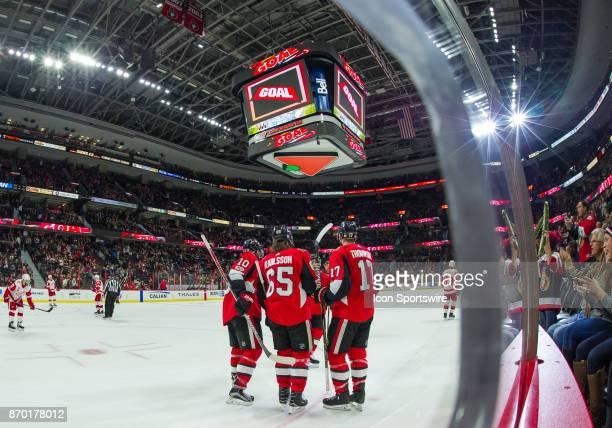 Ottawa Senators Tom Pyatt Erik Karlsson Nate Thompson and JeanGabriel Pageau celebrate the Senators second goal in the third period of the NHL game...