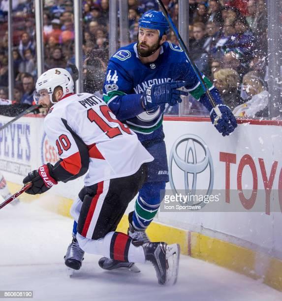 Ottawa Senators Winger Tom Pyatt battles with Vancouver Canucks Defenceman Erik Gudbranson during a NHL hockey game on October 10 at Rogers Arena in...