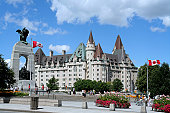 On the left hand side is the arch shaped Cenotaph with remains of the Unknown Soldier.  The historic Chateau Laurier hotel is in the background.