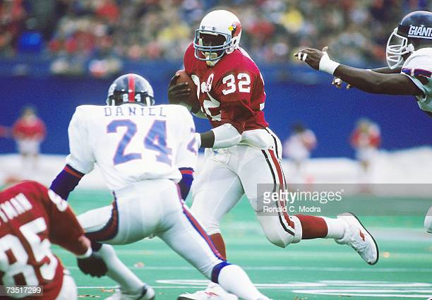 Ottis Anderson of the St Louis Cardinals carries the ball against the New York Giants on December 9 1984 in St Louis Missouri