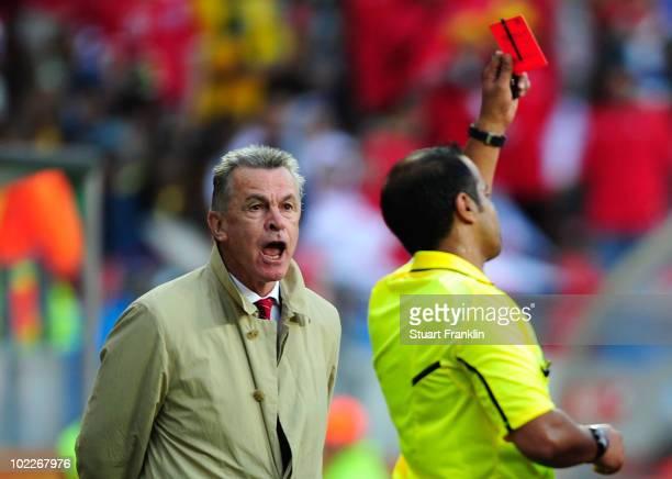 Ottmar Hitzfeld head coach of Switzerland shouts at Referee Khalil Al Ghamdi as he awards Valon Behrami of Switzerland a red card during the 2010...