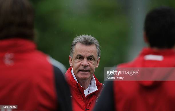 Ottmar Hitzfeld manager of Bayern Munich speaks to the team during a training session at Hong Kong stadium on June 30 2007 in Hong Kong China Two...