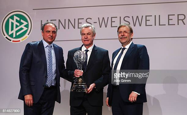 Ottmar Hitzfeld poses with Hansi Mueller and DFB Vice President Rainer Koch after receiving the lifetime achievement award during the Coaching Award...