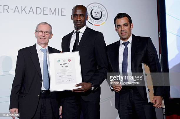 Otto Addo is honoured by Rainer Milkoreit and Robin Dutt during the Coaching and Technichal Development Course Awarding Ceremony on March 27 2013 in...