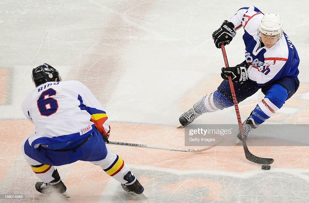 Otto Biro #6 of Romania skates against Kim Hyung Joon #10 of South Korea during the Ice Hockey Sochi Olympic Pre-Qualification Group J match between South Korea and Romania at Nikko Kirifuri Ice Arena on November 11, 2012 in Nikko, Tochigi, Japan. South Korea won 2-0.