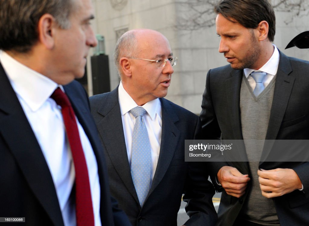 Otto Bruderer, managing director of Wegelin & Co., center, arrives at U.S. federal court in New York, U.S. on Monday, March 4, 2013. Wegelin & Co., Switzerland's oldest private bank, may pay U.S. authorities as much as $74 million after pleading guilty to helping American taxpayers hide assets from the Internal Revenue Service. Photographer: Louis Lanzano/Bloomberg via Getty Images