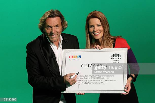 Otto Kern and Miriam Lange attend the voucher hands over to RTL 'Wir Helfen Kindern' at the RTL Studios on October 1 2012 in Cologne Germany