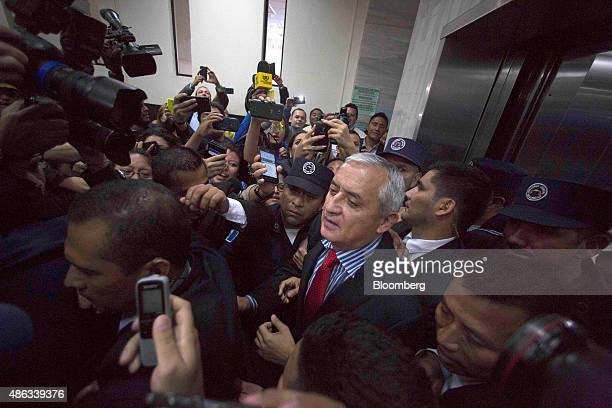 Otto Perez Molina Guatemala's president is surrounded by police and members of the media as he arrives at a court hearing to face corruption charges...