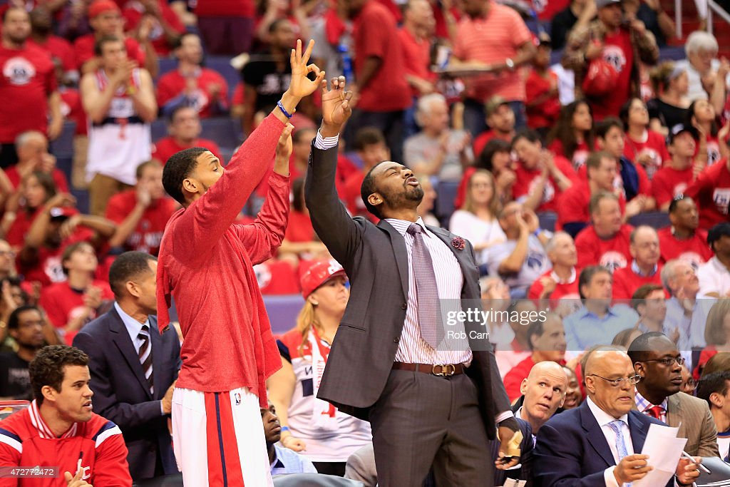 Otto Porter Jr. #22 (L) and John Wall #2 of the Washington Wizards react to a Wizards basket in the second quarter against the Atlanta Hawks during Game Three of the Eastern Conference Semifinals of the 2015 NBA Playoffs at Verizon Center on May 9, 2015 in Washington, DC.