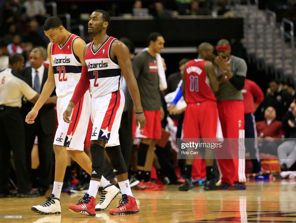 Otto Porter Jr. #22 and John Wall #2 of the Washington Wizards walk off the floor during a second half timeout against the Los Angeles Clippers at Verizon Center on December 14, 2013 in Washington, DC.