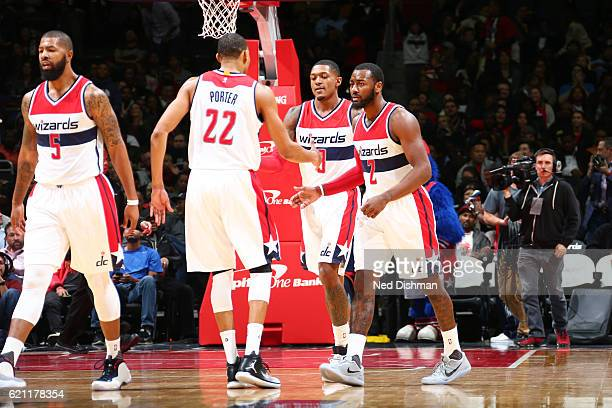 Otto Porter Jr #22 John Wall and Bradley Beal of the Washington Wizards celebrate during a game against the Atlanta Hawks on November 4 2016 at the...