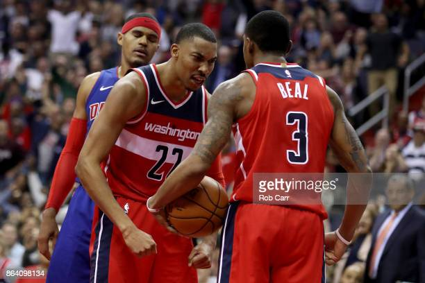 Otto Porter Jr #22 of the Washington Wizards and Bradley Beal celebrate after Beal scored and was fouled in the second half against the Detroit...
