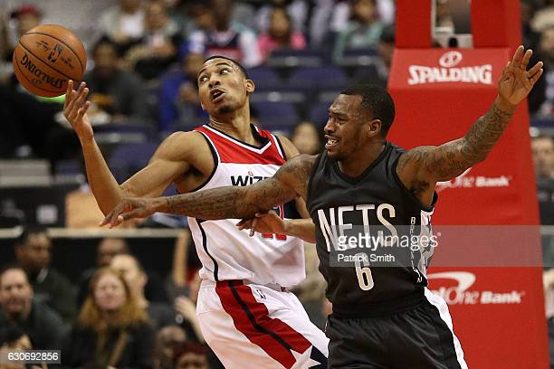 Otto Porter Jr #22 of the Washington Wizards battles Sean Kilpatrick of the Brooklyn Nets for a loose ball during the first half at Verizon Center on...