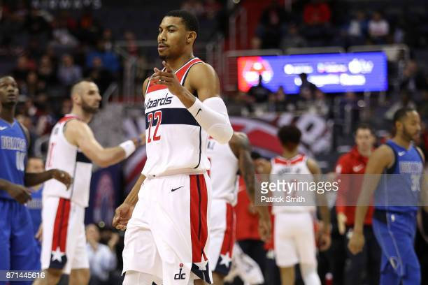 Otto Porter Jr #22 of the Washington Wizards celebrates a basket against the Dallas Mavericks during the first half at Capital One Arena on November...