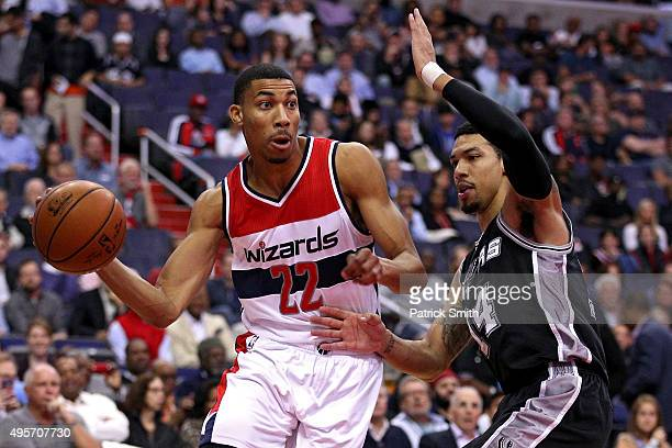 Otto Porter Jr #22 of the Washington Wizards dribbles past Danny Green of the San Antonio Spurs during the first half at Verizon Center on November 4...