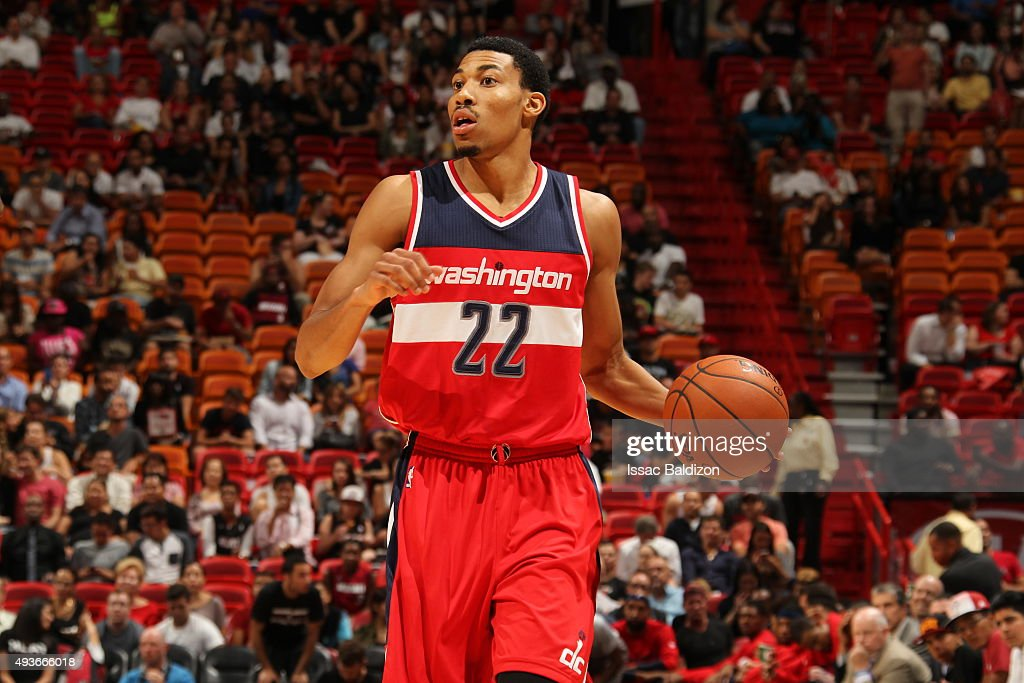 <a gi-track='captionPersonalityLinkClicked' href=/galleries/search?phrase=Otto+Porter+Jr.&family=editorial&specificpeople=10019906 ng-click='$event.stopPropagation()'>Otto Porter Jr.</a> #22 of the Washington Wizards dribbles the ball against the Miami Heat on October 21, 2015 at AmericanAirlines Arena in Miami, Florida.