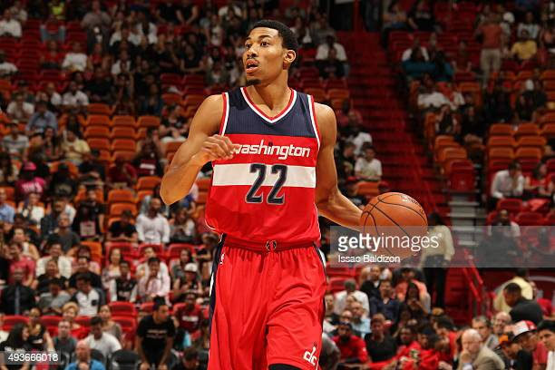 Otto Porter Jr #22 of the Washington Wizards dribbles the ball against the Miami Heat on October 21 2015 at AmericanAirlines Arena in Miami Florida...