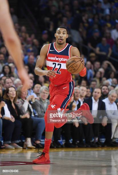 Otto Porter Jr #22 of the Washington Wizards dribbles the ball up court against the Golden State Warriors during their NBA basket ball game at ORACLE...