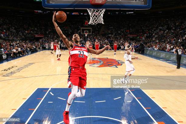 Otto Porter Jr #22 of the Washington Wizards dunks against the New York Knicks on October 13 2017 at Madison Square Garden in New York City New York...