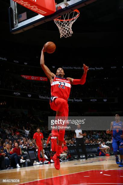 Otto Porter Jr #22 of the Washington Wizards dunks the ball during game against the Detroit Pistons on October 20 2017 at Capital One Arena in...