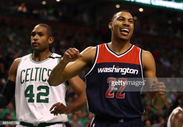 Otto Porter Jr #22 of the Washington Wizards reacts after a basket against Al Horford of the Boston Celtics during Game Seven of the NBA Eastern...