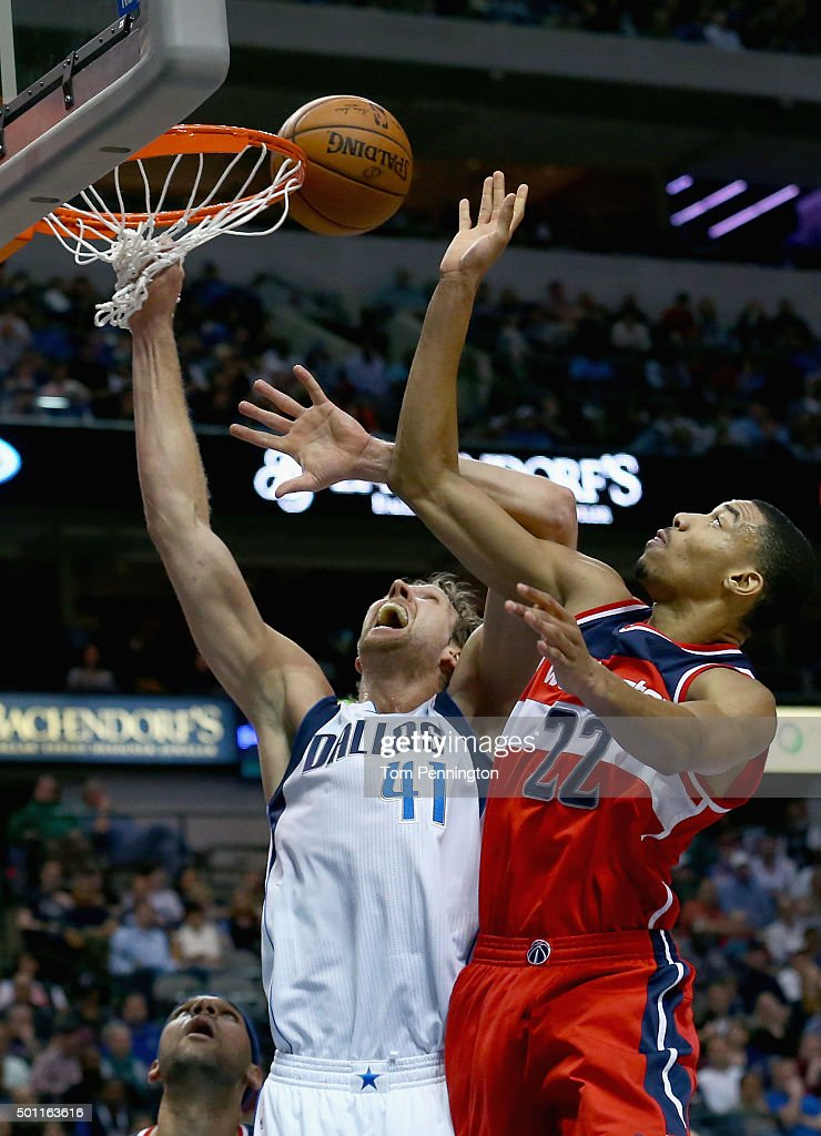 Otto Porter Jr. #22 of the Washington Wizards shoots the ball against Dirk Nowitzki #41 of the Dallas Mavericks at American Airlines Center on December 12, 2015 in Dallas, Texas.