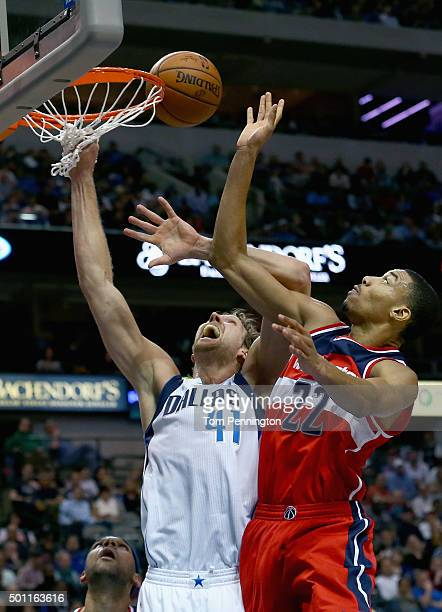 Otto Porter Jr #22 of the Washington Wizards shoots the ball against Dirk Nowitzki of the Dallas Mavericks at American Airlines Center on December 12...