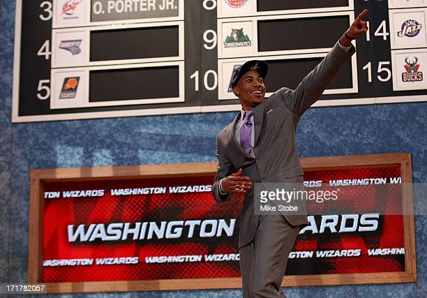Otto Porter of Georgetown reacts as he walks off stage after he was drafted overall in the first round by the Washington Wizards during the 2013 NBA...