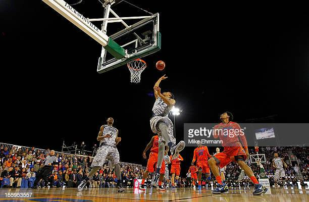 Otto Porter of the Georgetown Hoyas drives to the basket during the NavyMarine Corps Classic against the Florida Gators aboard the USS Bataan at...