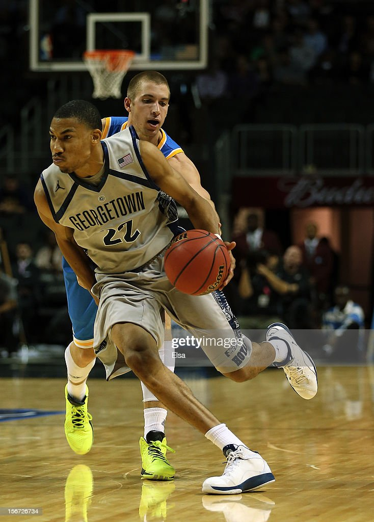 Otto Porter #22 of the Georgetown Hoyas is fouled by Travis Wear #24 of the UCLA Bruins during the Legends Classic on November 19, 2012 at the Barclays Center in the Brooklyn borough of New York City. The Georgetown Hoyas defeated the UCLA Bruins 78-70.
