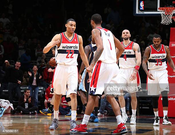 Otto Porter of the Washington Wizards celebrates a made 3point shot against the Memphis Grizzlies during the game at the Verizon Center on March 3...