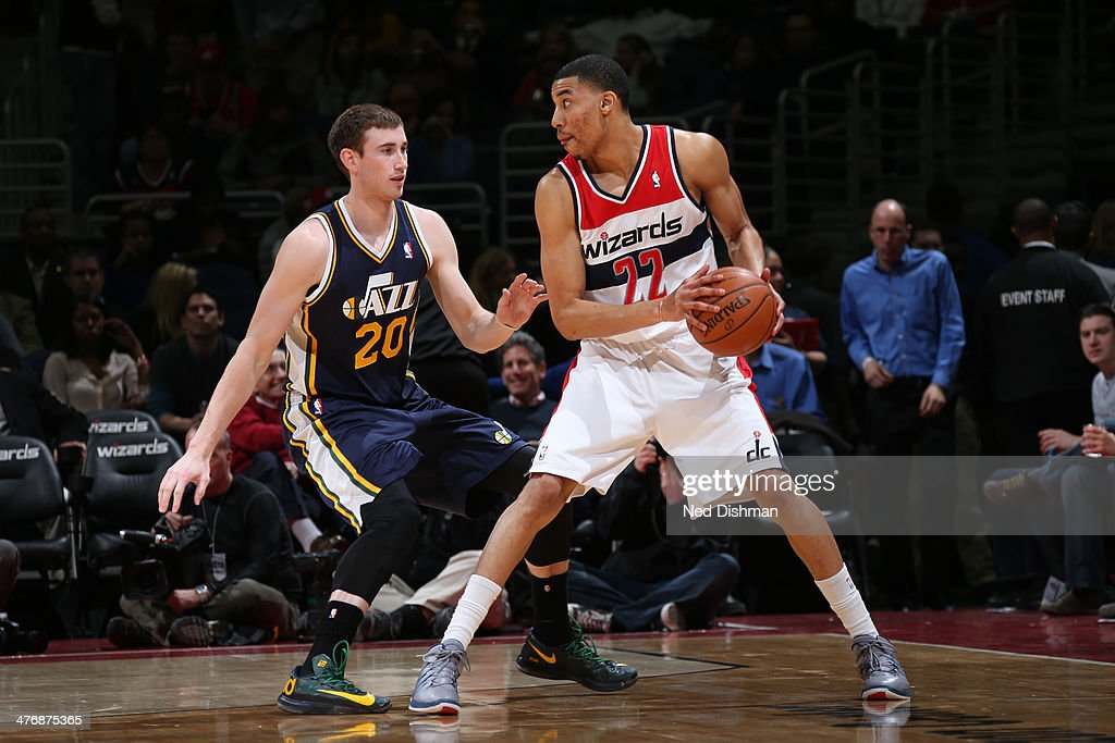 Otto Porter #22 of the Washington Wizards controls the ball against Gordon Hayward #20 of the Utah Jazz during the game at the Verizon Center on March 5, 2014 in Washington, DC.