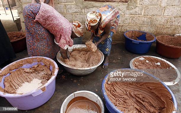 Women from a cooperative prepare shea butter 02 March 2007 in a neighborhood of Ouagadougou As cosmetics containing shea butter pop up on more and...