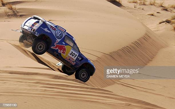 South Africa's Giniel De Villiers in a Volkswagen cruises over sandhills during the fourth stage of the 29th Dakar between Er Rachidia and Ouarzazate...
