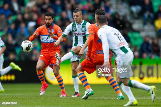 Ouasim Bouy of PEC Zwolle Jesper Drost of FC Groningen Danny Holla of PEC Zwolle Mimoun Mahi of FC Groningenduring the Dutch Eredivisie match between...