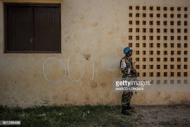 TOPSHOT 'Oui' is seen written on the walls of a polling station where a soldier of the UN peacekeeping force MINUSCA contingent is on guard in Bangui...