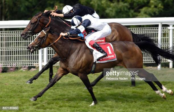 Ouija Board ridden by Frankie Dettori wins The Vodafone Nassau Stakes at Goodwood racecourse