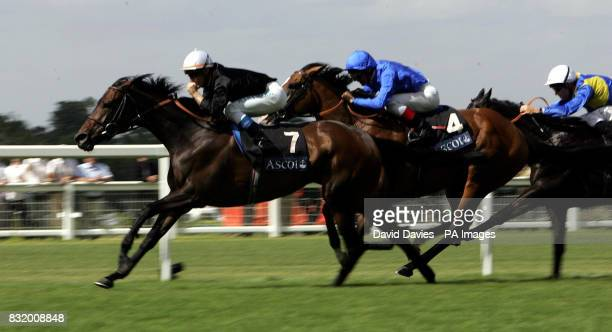 Ouija Board ridden by jockey Olivier Peslier wins ahead of Electrocutionist ridden by jockey Frankie Dettori in the Prince of Wales's Stakes at Ascot...