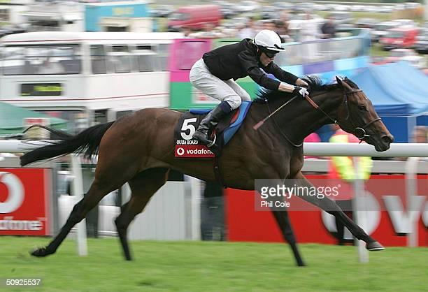 Ouija Board ridden by Kieron Fallon wins The Vodafone Oaks held at Epsom Racecourse on June 4 2004 in Epsom England