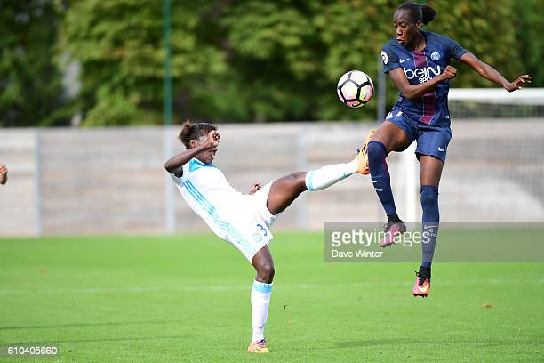 Ouleyemata Sarr of PSG and Anais MBassidje of Marseille during the women's French D1 league match between PSG and Olympique de Marseille at Camp des...